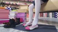 Stock Video Footage of Little girl trying on new white pink flats in childrens shoe store