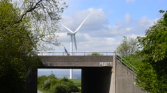 Electricity generating windmills by m18 motorway sheffield uk Stock Footage