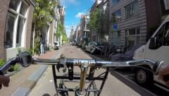 Bicycling thru alley Amsterdam Stock Footage
