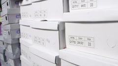 Dolly: Row of shoes boxes stacked in  shoe store Stock Footage