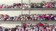 Stock Video Footage of Shelf  with shoes for kids in the children shoe store pan shot