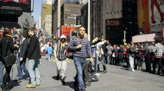 People walking busy crowded Times Square New Yorkers tourists slow motion 4K NYC Stock Footage
