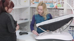 Buying infant electric rocker sleeper chair in baby and maternity shop - stock footage