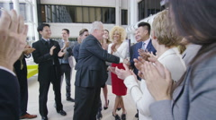 4k Confident diverse business team applauding their success and shaking hands Stock Footage