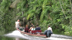 Group of tourists navigating on Cuyabeno river in Ecuadorian Amazonia Stock Footage