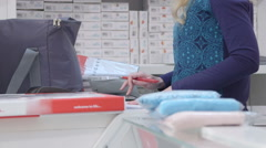 Checklist: Packing pregnancy hospital bag for pregnant women in baby  shop Stock Footage