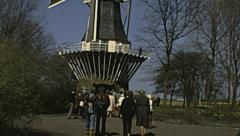 Holland 1977: people visiting a wind mill - stock footage