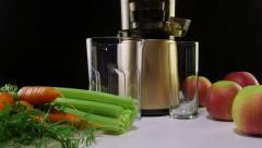 Stock Video Footage of Dolly: Cold press juicer for making freshly  juice from carrot apple and celery