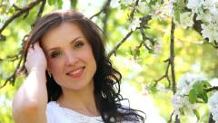Head and shoulders portrait of beautiful brunette woman. smiling woman face Stock Footage