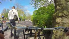 Maneuvering on bicycle in park Amsterdam Stock Footage