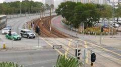 Street junction, car traffic crossing rails of tram, overhead view Stock Footage