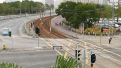 Comeng Light Rail Vehicle quickly drive away on curved rails line, overhead view Stock Footage