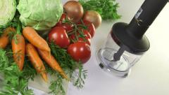 Using stick hand blender for chopping vegetables Stock Footage