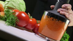 Dolly: Using stick hand blender with chopper attachment for chopping row carrot Stock Footage