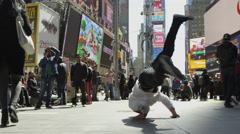 Windmills in Times Square; breakdancer breakdancing in public slow motion 4K NYC Stock Footage