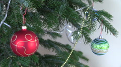 Christmas tree ball toys and decorations and blink white garland Stock Footage