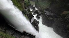 Pailon Del Diablo or Devils Cauldron waterfall in Ecuador, tourists snapping Stock Footage
