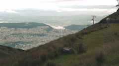 From Pichincha volcano zoom in all the way to the center of Quito in Ecuador Stock Footage