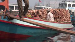 Closeup of laborers carrying bricks from a boat in Dhaka Stock Footage