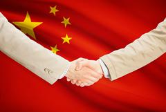 Businessmen shaking hands with flag on background - People's Republic of Chin Stock Illustration