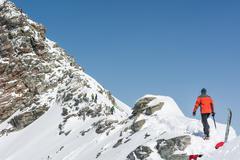 Person ascendind a mountain Stock Photos