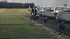 England 1970s: pilots leaving Piper aircraft after landing Stock Footage