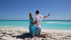 Bride and groom looking at the sea Stock Footage