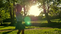 Young girl picking blossoms in sunny spells 4K Stock Footage