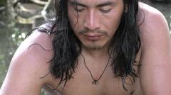 Indigenous hunter watching his fresh capture of medium size piranha fish Stock Footage