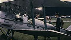 England 1970s: spectators visiting aircrafts during an air show - stock footage