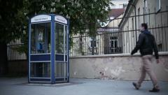 Night Eastern Europe. Young man is calling for a payphone Stock Footage