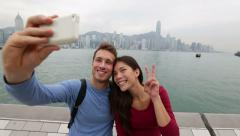 Selfie tourist couple taking picture in Hong Kong - stock footage