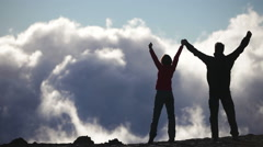 Happy hikers reaching life goal - success people enjoying accomplishment - stock footage