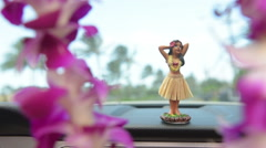 Hawaii travel car - Hula girl dancing and lei Stock Footage