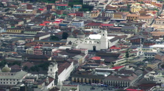 Camera panning left to right over the old town of Quito Stock Footage