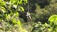 Stock Video Footage of Adult woman crossing approaching the camera in inverted position while zip line