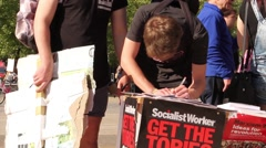 Man Signing Petition - UK Austerity Protests, Bristol 2015 HD Stock Footage