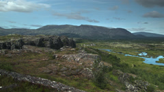 Wide view of Mountains and River Valley in the Thingvellir national park ICELAND Stock Footage