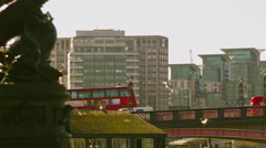 Red bus crossing the Lambeth Bridge Stock Footage