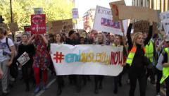 Protest Chanting Against Conservative Government Spending Cuts on NHS Healthcare - stock footage