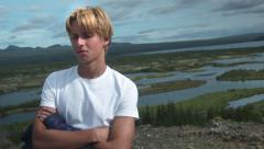 Blond young man, Tourist in ICELAND Stock Footage