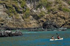 Unidentified tourists enjoying a daytrip kayaking in beautiful paradise beach Stock Photos