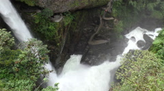 Camera move down and swift to reveal the entire Pailon del Diablo waterfall in Stock Footage