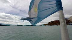 Patagonia Argentina Flag and Glacier Lake 4K Stock Footage