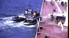 Tugboats Push Oil Tanker Commercial Shipping 1960s Vintage Film Home Movie 8389 Stock Footage