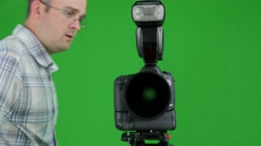 Green screen shot of a photographer in the studio Stock Footage