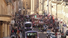 Thousands of People March Down Street - UK Austerity Protests: Election 2015 HD Stock Footage