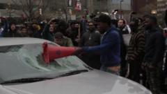 Rioters Breaking Undercover Police Car - stock footage