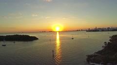 Crandon Marina Boat Sails off Into Sunset Clip 2 Stock Footage