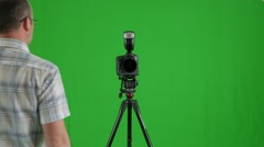 Green screen shot of a photographer Stock Footage